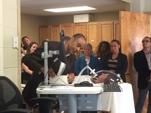 Dr. Ryan Mitchell, associate professor with The Sage Colleges' Nutrition Science department, demonstrates how to use a metabolic heart monitor in the newly renovated Nutrition and Physical Assessment Laboratory