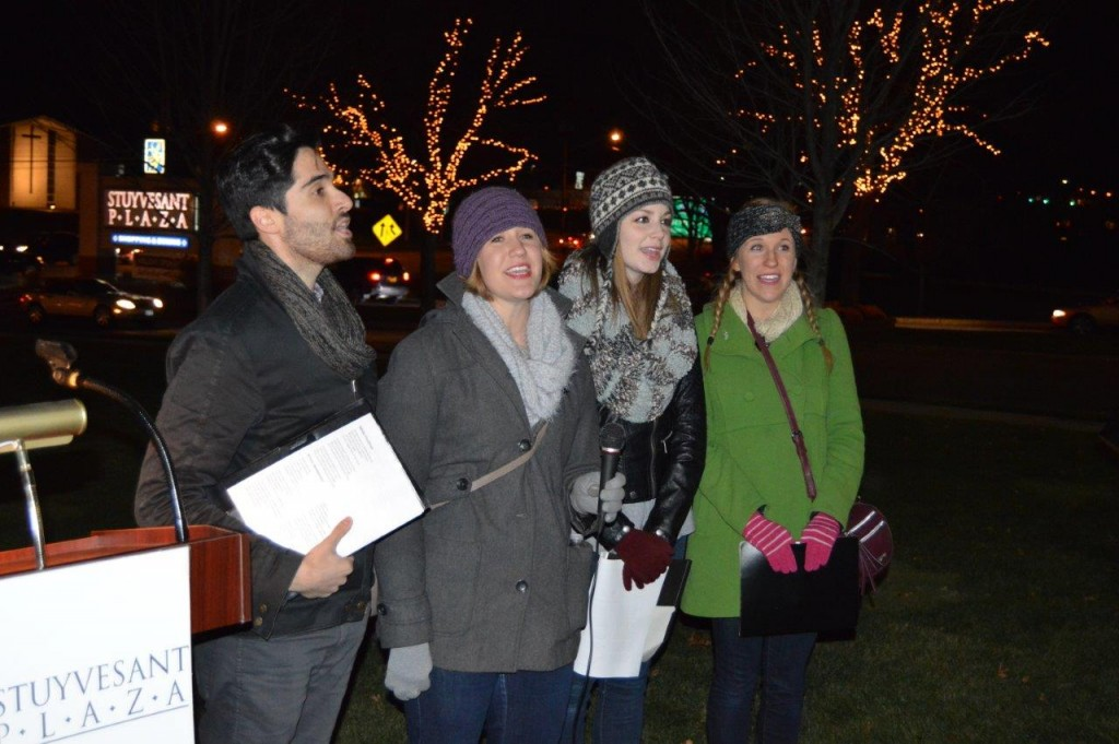 Performers from Park Playhouse sing a holiday song.