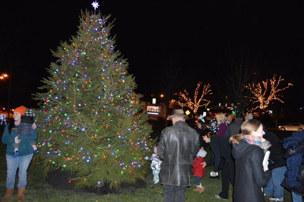 Shoppers gather to admire the decorative 14-foot holiday tree.