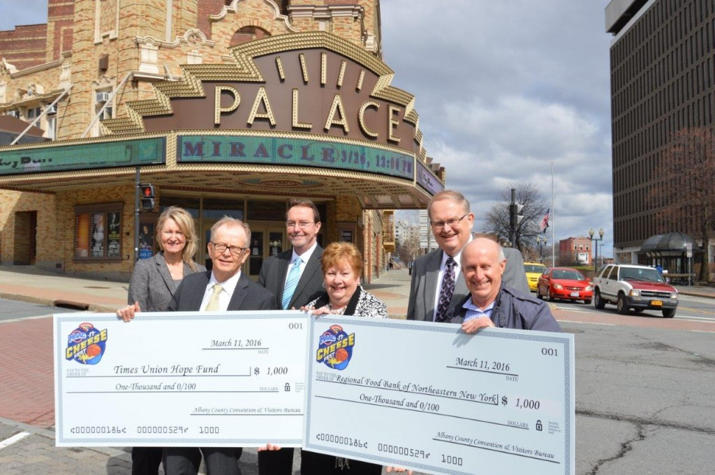 The Albany County Convention and Visitors Bureau (ACCVB) and Hannaford Supermarkets presented the Regional Food Bank of Northeastern New York and the Times Union Hope Fund each with a $1,000 check outside the Palace Theatre in Albany, NY on Friday, March 11. The non-profits were the beneficiaries of the Hannaford MAAC-n-Cheese Fest held on March 4 in celebration of the Metro Atlantic Athletic Conference (MAAC) Basketball Championships. The check presentations took place as the ACCVB and Times Union Center announced details of the NCAA Division I Men's Ice Hockey East Regional and College Hockey Fest 2016 in downtown Albany on Saturday, March 26 and Sunday, March 27. Pictured (L to R) are Holly Brown, Executive Director, Palace Theatre; Mike Spain, Associate Editor, Times Union; Bob Belber, General Manager, Times Union Center; Michele Vennard, President and CEO, Albany County Convention and Visitors Bureau; Dave Farrell, Store manager, Hannaford Supermarkets; and Mark Quandt, Executive Director, Regional Food Bank of Northeastern New York;