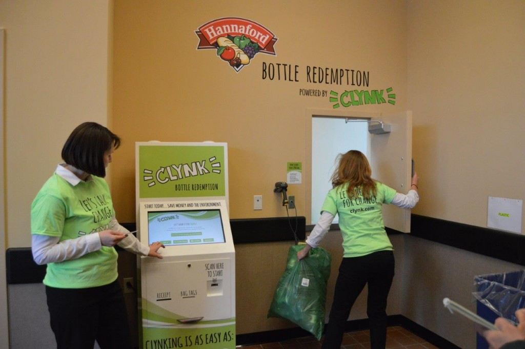 CLYNK ambassadors demonstrate how to use the new bottle redemption service.