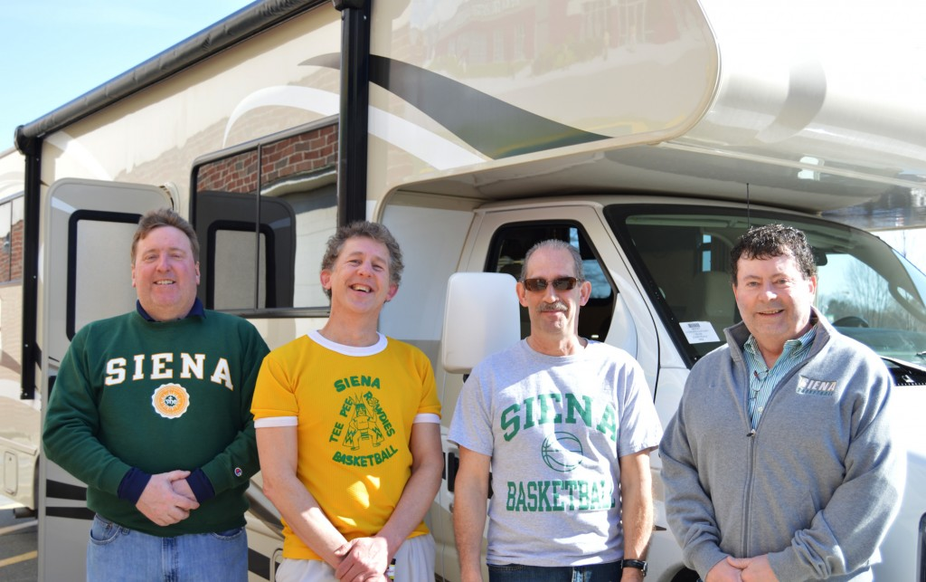 Siena College alumni Joe Altieri, Robert Folkl, Keith Perry, and Shane Somerville (left to right) prepare to board an Alpin Haus RV at Siena College in Loudonville, NY on Friday, February 24 to see the Siena men's basketball team play Monmouth in New Jersey.