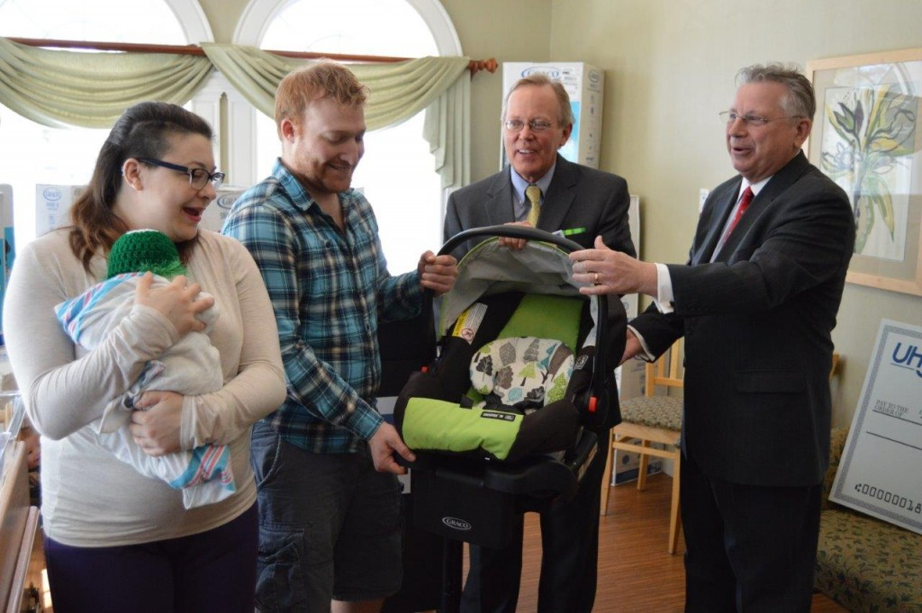From right, UHY LLP Office Managing Partner – Capital Region Howard Foote; Ellis Medicine President and Chief Executive Officer Paul Milton; and new parents Steve Badala and Giana Mazzatta. The parents were provided the safety device to transport their newborn, Ruxin Salvatore Badala, who was recently born at Bellevue Woman's Center.