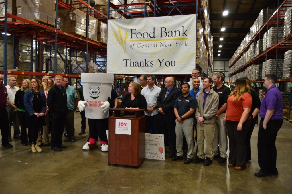 Food Bank of Central New York Chief Operating Officer Karen Belcher speaks during the press conference, flanked by Dunkin' Donuts franchisees and associates.