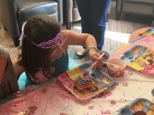 Central New York Wish Kid Lilianah Winship decorates her own star donut