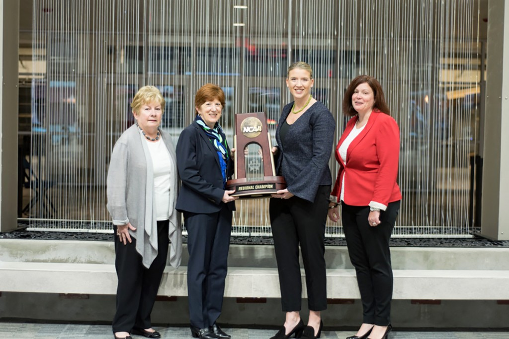 City of Albany Mayor Kathy Sheehan (second from left) and Siena women's basketball head coach Ali Jaques (third from left) display the official championship trophy for the NCAA Women's Basketball Albany Regional at the Times Union Center in Albany, NY. Mayor Sheehan and Coach Jaques were joined by Michele Vennard, president and CEO of the Albany County Convention and Visitors Bureau (left) and Georgette Steffens, executive director of the Downtown Albany Business Improvement District (right),