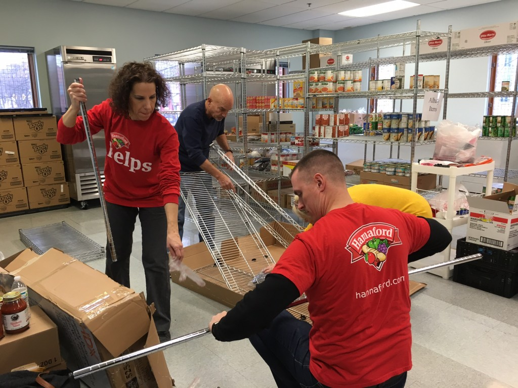 Hannaford Supermarkets Community Relations Specialist Brian Fabre (front right) and Community Relations Assistant Francesca Mancino (front left) are joined by volunteers from The Food Pantries for the Capital District.