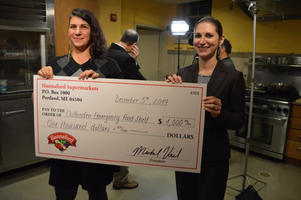 Hannaford Supermarkets Director of Operations Samara Bushey (right) presents Seven Days Food Writer Suzanne Podhaizer (left) with a donation for the Chittenden Emergency Food Shelf.