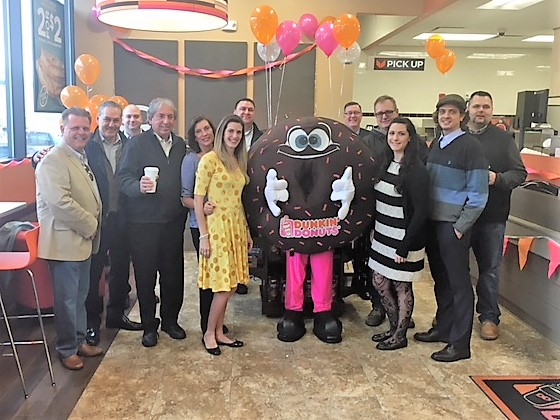Pictured from left to right: Dunkin' Donuts Franchisee Carlos Teixeira, Paul Fallati, Tom Gabriel, David Buicko, Marta Teixeira, Dunkin' Donuts Franchisee Natasha Teixeira, Steve Luciano, Dunkin' Donuts mascot Sprinkles, Dunkin' Brands Operations Manager Tom Juers, Brian Barton, Dunkin' Donuts Franchisee Nicole Teixeira, Dunkin' Donuts Franchisee Miguel Teixeira, and Frank Drzewiecki